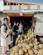 Local farms supply Pul-e Khishti Bazaar with vegetables and fruit, including melons.