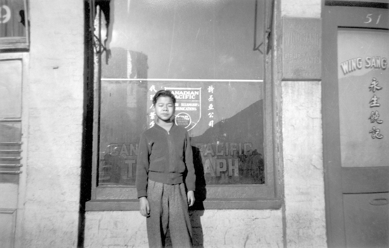Yip Sang's son, Mel Yip in front of Wing Sang building in Chinatown