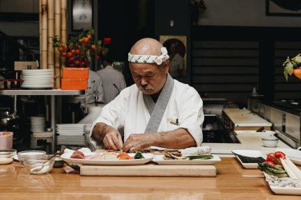 Chef Hidekazu Tojo makes sushi