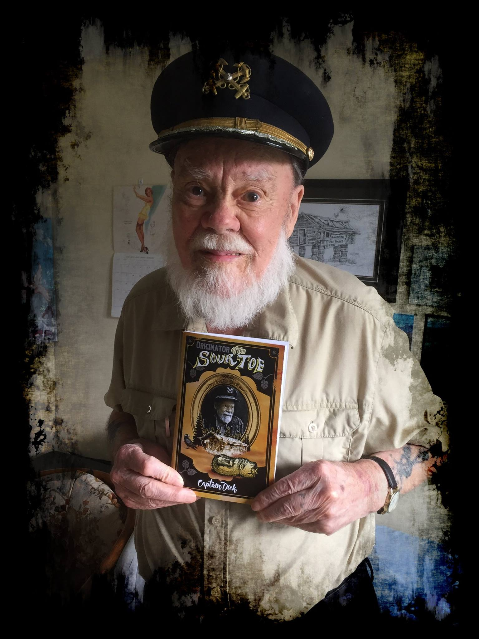 Captain Dick Stevenson proudly displays his self-published autobiography in this 2016 photo. Photo: Facebook