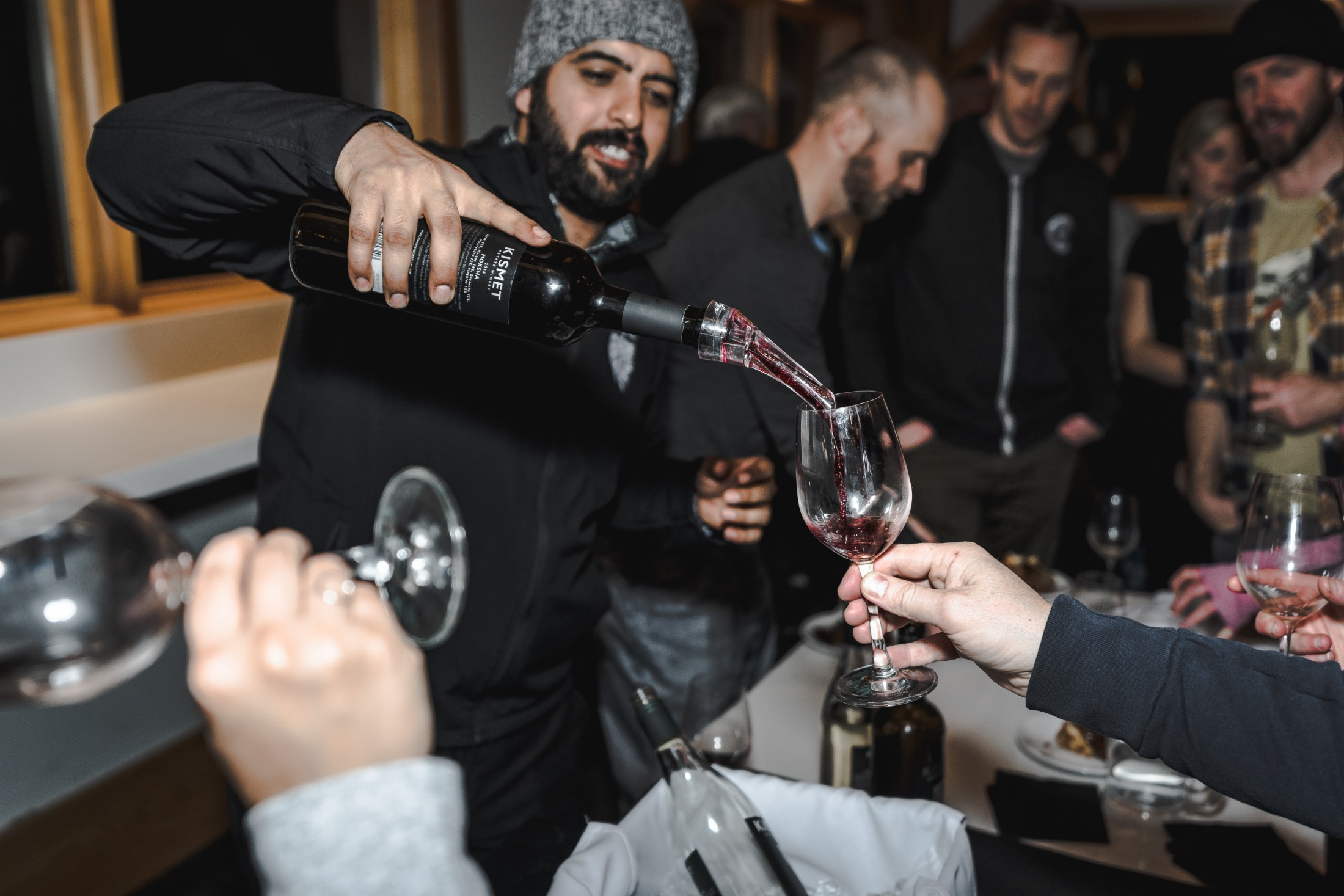 Dapinder Gill pours Moksha wine from Kismet. Photo by Kyle James/Oliver Osoyoos Wine Country.