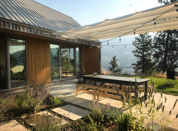 This Unique Okanagan Home's Spacious Wings Embrace a Private Open-Air Courtyard