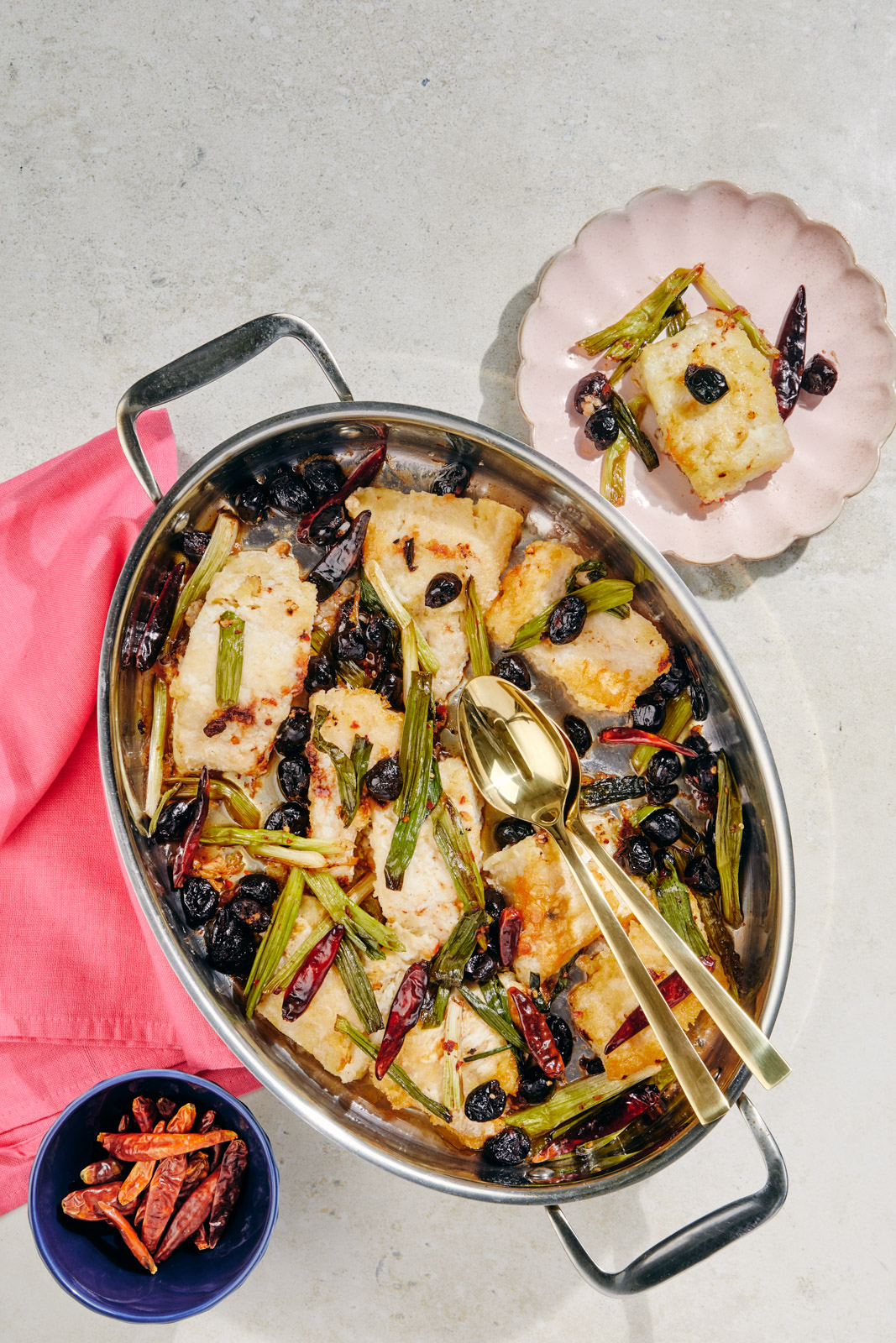 Baked codfish with chilis and olives