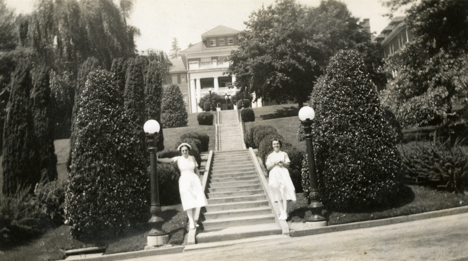 Nurses in front of the West Lawn Building at Essondal